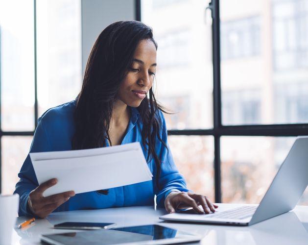 woman blue shirt laptop desk