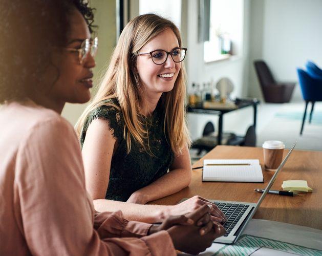 two women laptop office